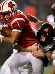 Kimberly's DJ Stewart tries to break a tackle against