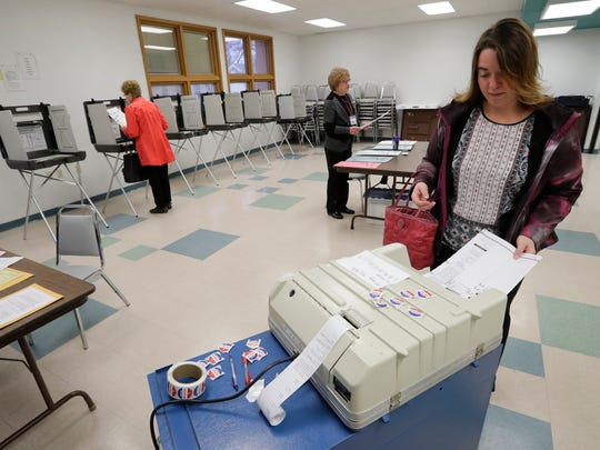 Casey Belanger casts her ballot Tuesday at the Gerard H. Van Hoof Memorial Library & Civic Center in Little Chute.