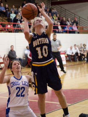 Port Huron Northern's Sami Klink shoots on CrosLex's Claire Knapp Thursday, Dec. 22 at Port Huron High School.