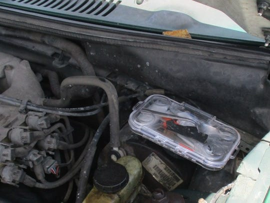 Drugs were found in the engine compartment of a car
