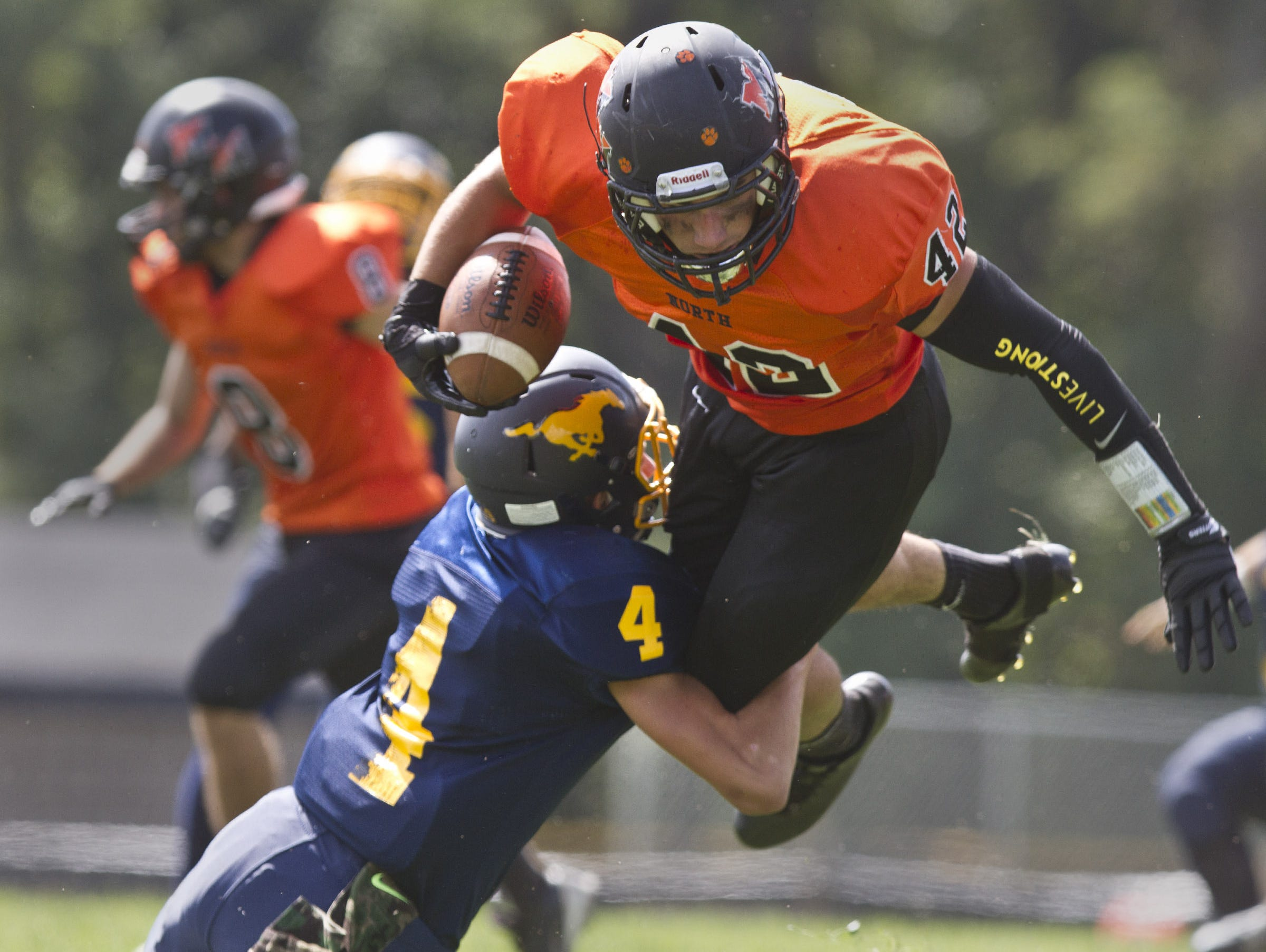 Middletown North, led by senior running back/linebacker Chad Freshnock, shown hurdling over a Marlboro defender on Sept. 19, will try to set up the prospect of playing Middletown South two weeks in a row with a win over Sayreville Friday night in an NJSIAA North II, Group IV quarterfinal-round game.