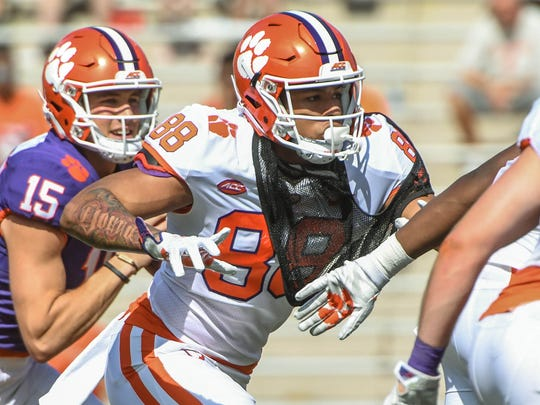 Clemson tight end Braden Galloway blocks for quarterback Hunter Johnson (15) during the the spring game in Memorial Stadium in Clemson on Saturday, April 14, 2018.