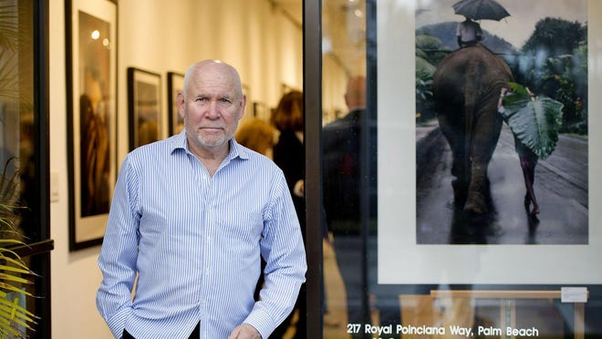 "Photographer Steve McCurry visits Palm Beach to sign his new 252-page book ""Animals"" during a reception Thursday at Coe + Co Photography Gallery."