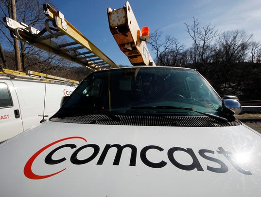 AP EARNS COMCAST F FILE USA PA
