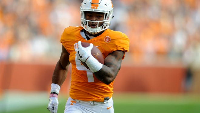 Tennessee running back John Kelly (4) runs for a touchdown against Tennessee Tech during the first half at Neyland Stadium on Saturday, Nov. 5, 2016.