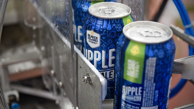 Cans of Ripple roll off the new canning line Wednesday, May 24, at Beaver Island Brewing Co. in St. Cloud.