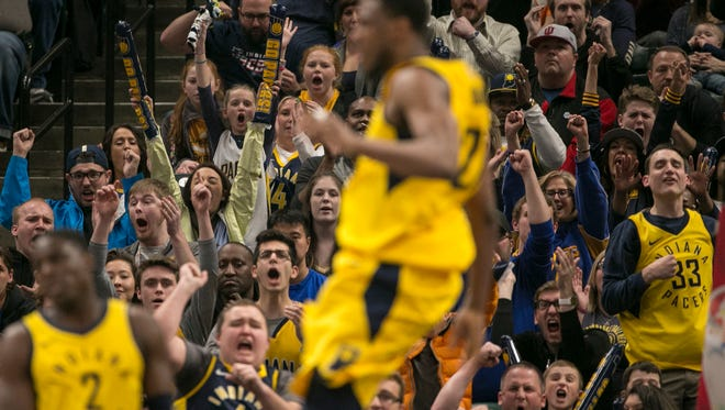 Fans cheer after an overtime score by Indiana, Miami Heat at Indiana Pacers, Bankers Life Fieldhouse, Indianapolis, Sunday, March 25, 2018. Pacers won 113-107 in overtime.
