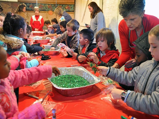 Children visiting Santa House at the Kell House Museum Friday got to make their own keepsake ornaments usinf glue and glitter.