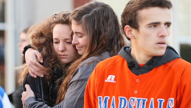 Two students hug after a prayer circle at Paducah Tilghman High School on Wednesday morning.  The students gathered to pray for the students of Marshall County High School students who were killed and injured during the shooting on Tuesday morning.January 24, 2018