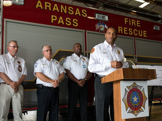 Fire Chef Darell Fullum from the Dekalb County Fire and Rescue department in Georgia, speaks during a press conference at the Aransas Pass Fire Station where where firefighters from the Metro Atlanta area donated $225,000 to assist firefighter's recovery on Wednesday, Oct 11, 2017.