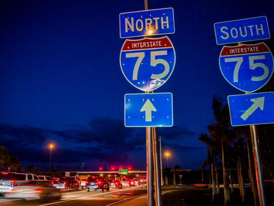 Cars travel along Immokalee Road in North Naples on Monday, Nov. 20, 2017.