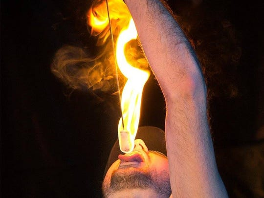 JC Spinner, of Spinner Entertainment, eats fire.