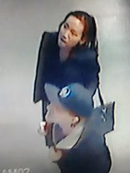 Shoplifter taken from security camera at Famous Faces and Funnies in West Melbourne.