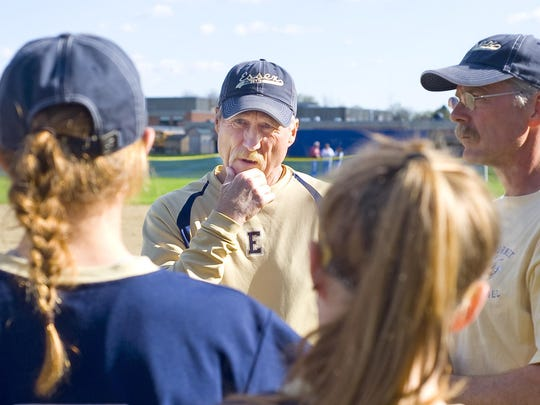 Essex High School softball coach Bill O'Neil speaks with his players between innings against Champlain Valley Union High School in Essex Junction on Monday, May 9, 2011.