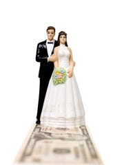 Wedding couple standing on a Dollar Bank Note