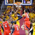 Cleveland Cavaliers' Tristan Thompson gets past Atlanta Hawks defenders Kent Bazemore, Paul Millsap, Shelvin Mack and Mike Scott, from left, for a dunk, with LeBron James watching during Game 4 of the Eastern Conference finals of the NBA basketball playoffs, Tuesday, May 26, 2015, in Atlanta. The Cavaliers won 118-88. (Curtis Compton/Atlanta Journal-Constitution via AP)