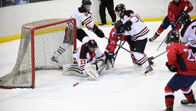 Holding the fort during this Livonia Franklin scoring bid is Livonia Churchill freshman goalie Bryant Riley (33).