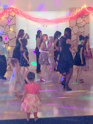 Line dancing at the family dance prompted a younger