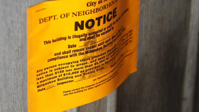 An eviction notice is posted on the door of a trailer home in Milwaukee.
