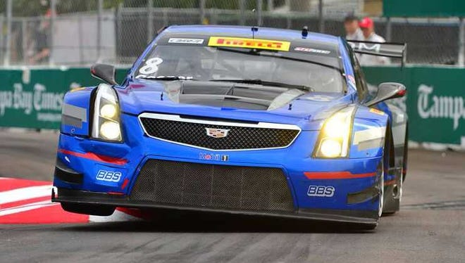 Michael Cooper launches his Cadillac over a curb during Pirelli World Challenge competition on the streets of St. Petersburg, Fla.