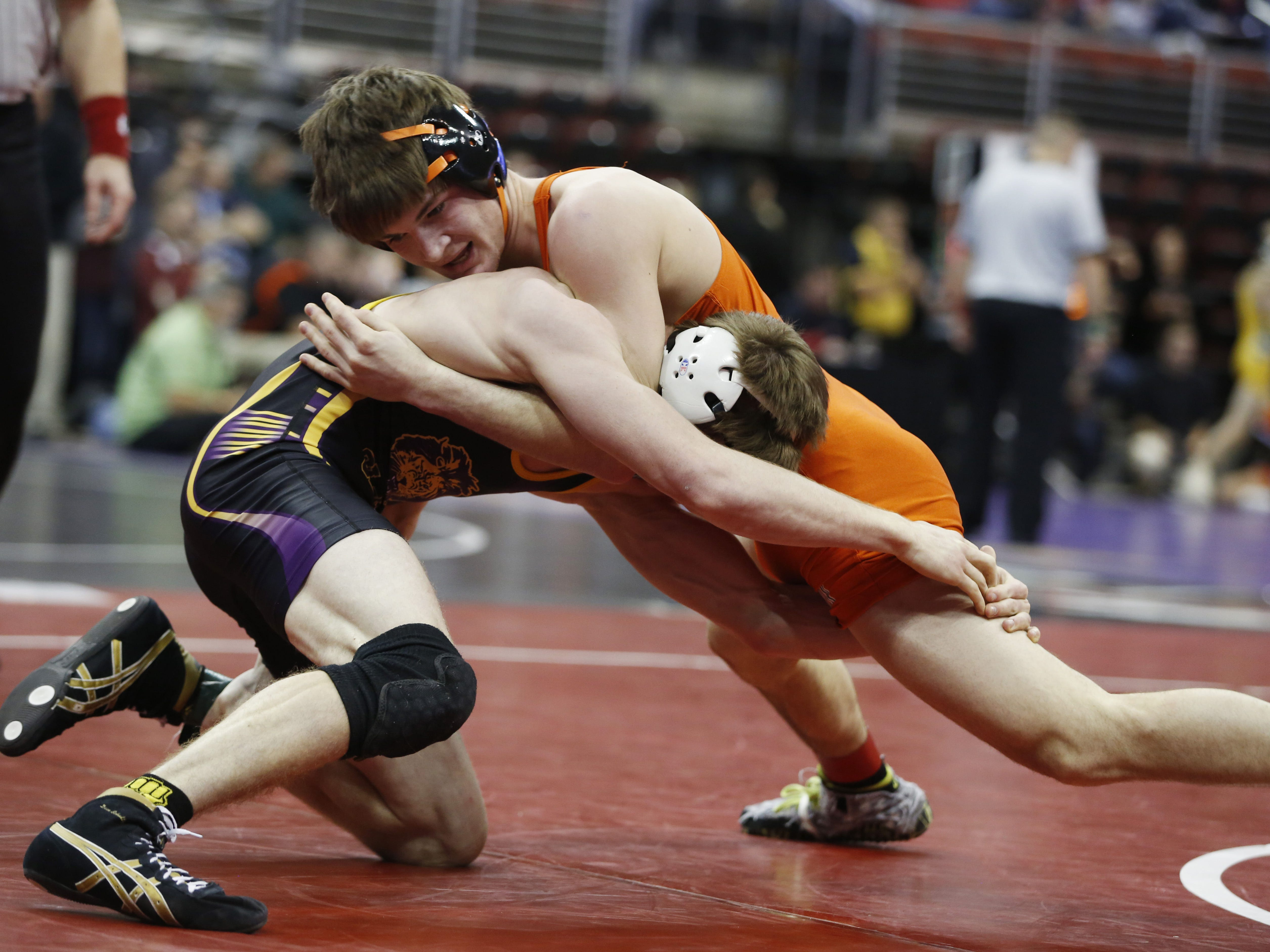 Solon's Cole Fritz (top) wrestles with Central Lyon's Colby McIntire in their Class 2A, 138 pound first-round match at the state wrestling tournament on Thursday