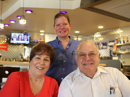 Ed and Georgette Mourad, sitting, have parted ways with Big Boy and will open their own restaurant, Mourad's Grill, in the same location on Tuesday. With them is restaurant manager Suzi Avery.