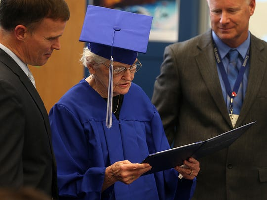 San Angelo resident Betty Jo Griffin, 90, reads the honorary high school diploma she received from San Angelo ISD's Lake View High School Monday, May 14, 2018.