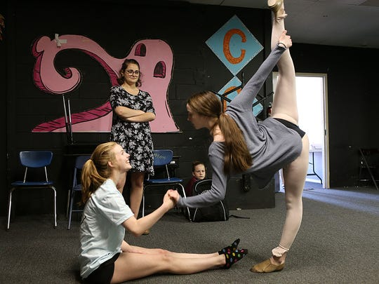 Home-schooler Emma Armstrong, a ballet instructor at the San Angelo Broadway Academy, critiques dancers Faith Magee (right) and Holly Magee during practice Wednesday, May 16, 2018.
