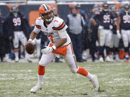 FILE - In this Dec. 24, 2017, file photo, Cleveland Browns quarterback DeShone Kizer rolls out during the second half of the team's NFL football game against the Chicago Bears in Chicago. The Browns have sent Kizer to the Green Bay Packers in one of three trades Friday, March 9, 2018. A person with direct knowledge of the overhaul told The Associated Press about the trades on condition of anonymity. Teams are not permitted to announce any trades until next week. (AP Photo/Charles Rex Arbogast, File)