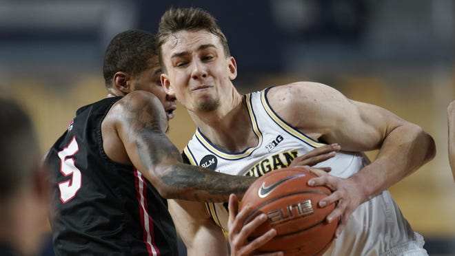 Michigan guard Franz Wagner (21) drives on Ball State guard Ishmael El-Amin (5) in the first half of an NCAA college basketball game in Ann Arbor, Mich., Wednesday, Dec. 2, 2020.