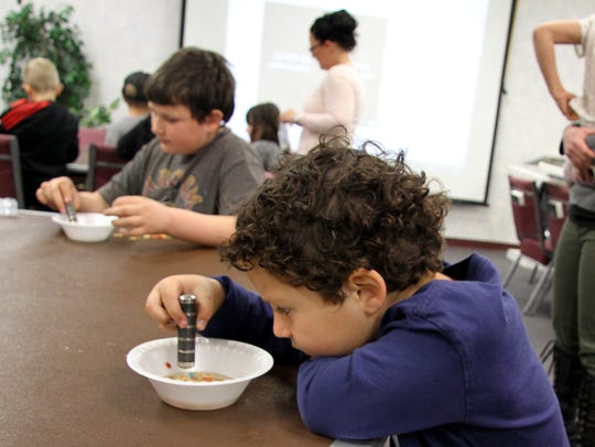 Asher Marancenbaum, 5, used a magnet on a bowl of breakfast