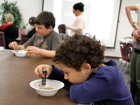 Asher Marancenbaum, 5, used a magnet on a bowl of breakfast cereal.