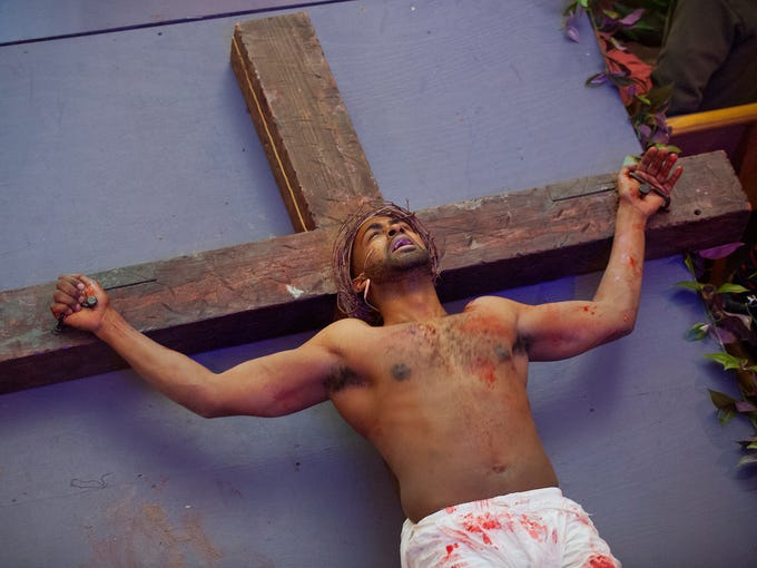 Christ (Channing Banks) is crucified in the Bates Memorial
