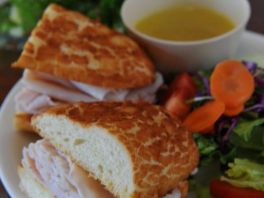 A turkey dip sandwich joins a Greek salad at Dandelion Deli.