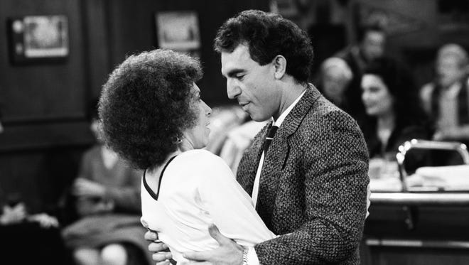 """Rhea Perlman as Carla Tortelli and Jay Thomas as Eddie LeBec get close in """"Never Love a Goalie: Part 1"""" Episode 16 of 'Cheers.'"""