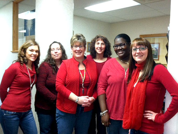 The women of Heritage Christian Services show their red for National Wear Red Day on Friday, Feb. 7. The campaign is to promote awareness of women's heart health.