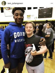 Godby freshman Julian Green poses for a photo with Arnold's Skyler Jarrell after the two wrestled Friday.