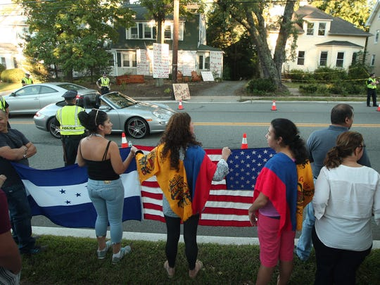 Morristown Latino residents, offended by signs posted at a Speedwell Avenue home,  gathered in force to express their outrage. September 16, 2015, Morristown, NJ.