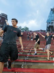 Cincinnati fans rush the stands after being asked to seek shelter due to lightning.