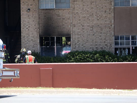 Officials with the San Angelo Fire Department and San Angelo Police Department investigate an fire at the Arden Ridge Apartments that claimed one life in the 3800 block of Arden Road, July 2, 2018.