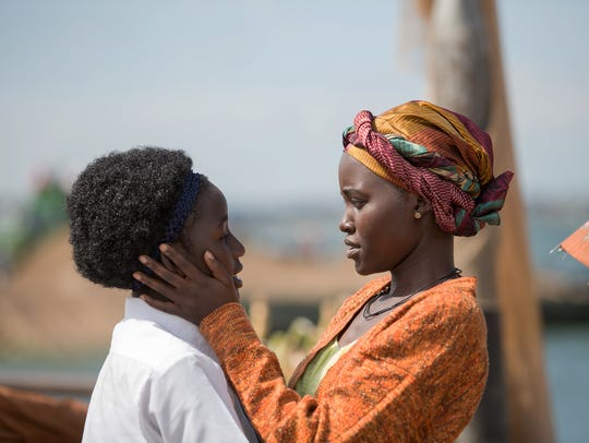 In this image released by Disney, Lupita Nyong'o, right,