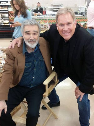 WVLT's Alan Williams, right, poses with Burt Reynolds when Reynolds was in Knoxville working on a film.