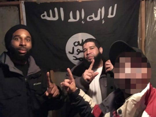 Edward Schimenti, Joseph Jones and an undercover FBI source are pictured in front of an ISIS flag.