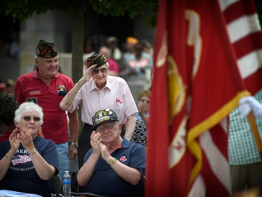 Dan Lucas, a 101-year-old veteran of D-Day at Normandy Beach, salutes after being recognized by Leanna Dietrich during the 34th Memorial Day program at Indiantown Gap National Cemetery that took place Sunday afternoon, May 29.