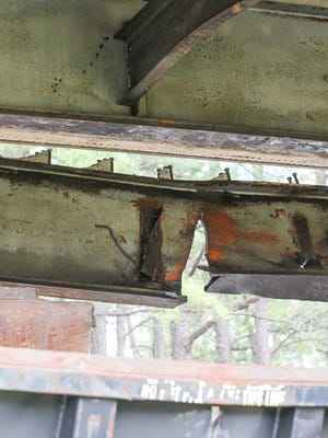 A steel beam is damaged and bolts separated from the concrete above it Wednesday on the S.C. 20/U.S. 29 Connector bridge over U.S. 29 North near Williamston.
