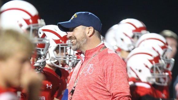 Tappan Zee football coach Andy DiDomenico smiles at his team as they beat Byram Hills 27-20 at Tappan Zee Oct. 9, 2015.