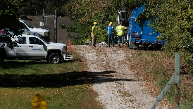 Crews at the site of a natural gas leak at a Consumers Energy facility off Airport Rd. near Clark Rd. in Watertown Township Saturday, Sept. 30, 2017.