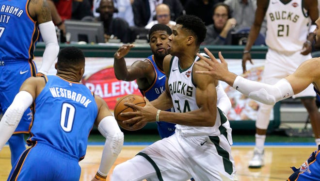 Giannis Antetokounmpo drives toward the basket.