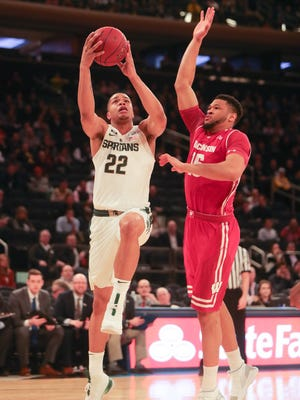 Michigan State guard Miles Bridges drives against Wisconsin forward Charles Thomas during the first half of the Big Ten tournament quarterfinal on Friday, March 2, 2018, at Madison Square Garden.