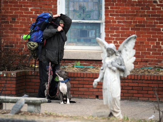 A homeless man prepares to spend the night somewhere around downtown Asheville Monday afternoon as bitter cold descended.